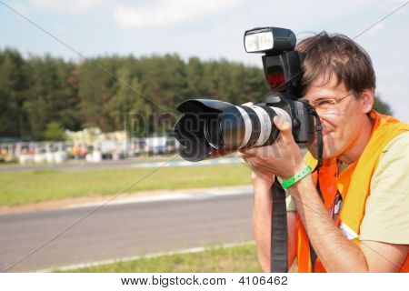 Photographer On Race Focus On Lense