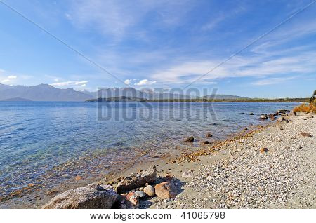 Gravel Beach On A Coastal Lake