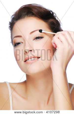 Applying Eyeshadow Using Cosmetic Applicator