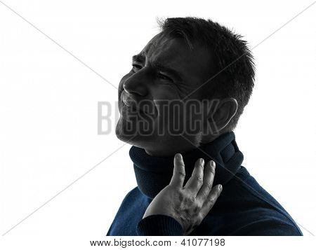 one caucasian man with cervical collar neck ache  portrait in silhouette studio isolated on white background