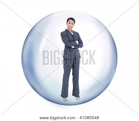 Businesswoman standing at a bubble while arms crossed