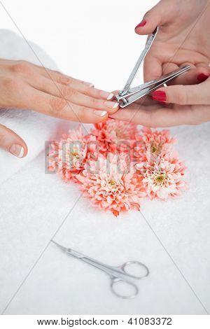 Close-up of woman cutting fingernail at nail salon