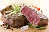 stock photo of ribeye steak  - beef steak with herbs - JPG