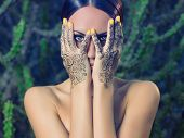 picture of mehendi  - Beautiful young lady with painted hands mehendi - JPG