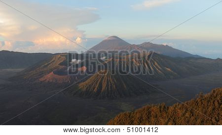 Sunrise over valley with volcanoes Bromo, Batok and Semeru. Java island, Indonesia