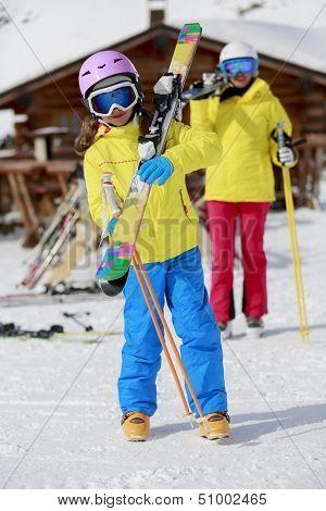 Ski, ski resort, winter sports - family on ski vacation, apres ski