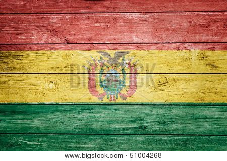 bolivian flag on wood texture background