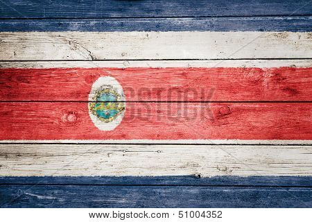 costa rican flag on wood texture background