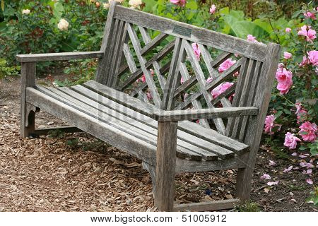 Park Bench in a Flower Garden