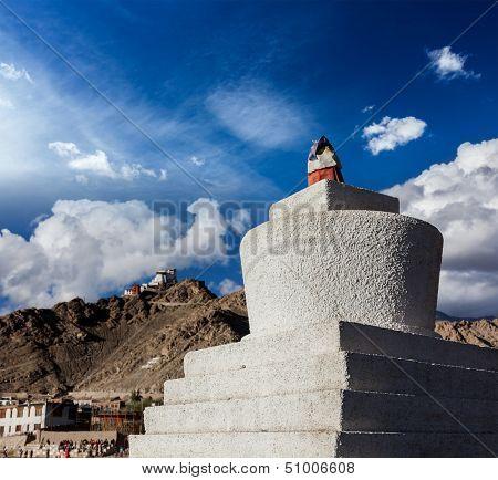 Whitewashed chorten and Tsemo fort and gompa. Leh, Ladakh, India