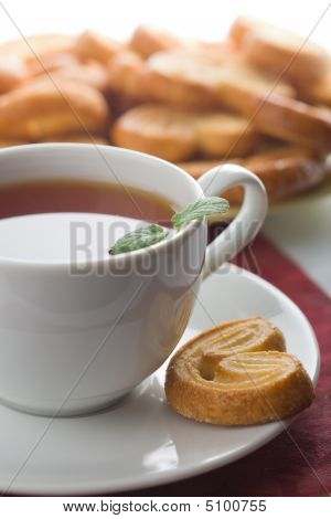 Cup Of Tea And Cookies Isolated