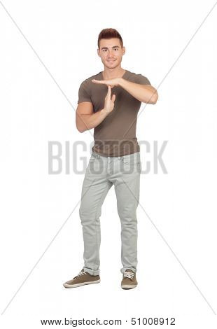 Attractive guy with spiky hair gesturing time-out isolated on white background
