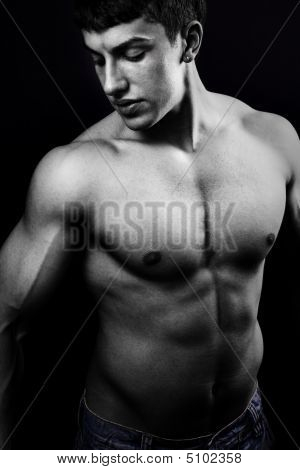 Muscular Young Man In The Dark