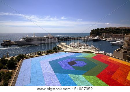 Colourful helicopter landing in Monaco port