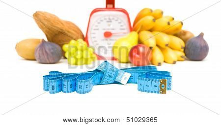 Measuring Tape, Kitchen Scale And Vegetables On A White Background