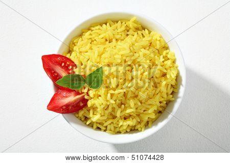 Looking down at a bowl of yellow rice dish