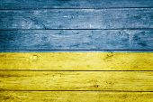 ukrainian flag on wood texture background