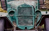picture of truck farm  - Close up front view of old abandoned rusted truck with empty headlamps - JPG