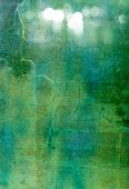 Abstract textured background: blue, green, and white patterns on dark backdrop. For art texture, gru