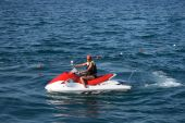 stock photo of waverunner  - An adult man on a wave runner at sea - JPG