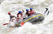 stock photo of raft  - Extreme River Rafting splashing the white water - JPG