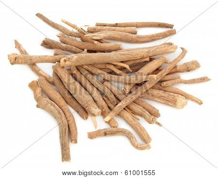 Ginseng herb in a pile over a white background.