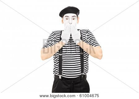 Shocked mime artist standing in disbelief isolated on white background