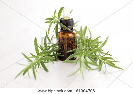 bottle of rosemary essential oil - beauty treatment