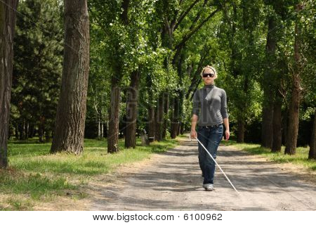 blind woman walking outside