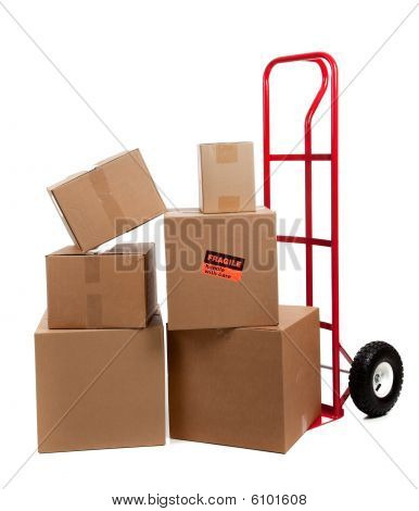 Moving Boxes on a red dolly With Fragile Stickers