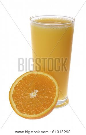 Tall full glass of orange juice with half orange on white backround