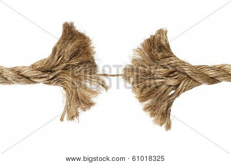 Frayed rope about to break on white background