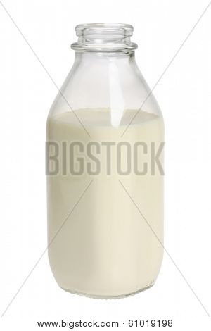 Glass bottle of milk on white background