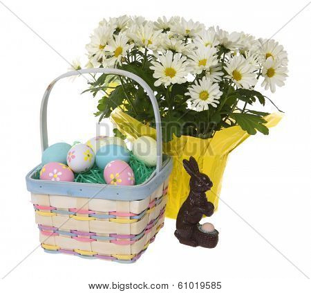 Easter basket with colored eggs flowers and rabbit