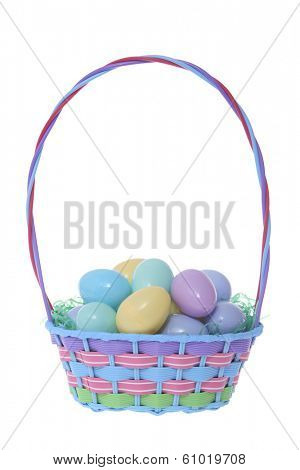 Colored Easter basket with solid color eggs on white background
