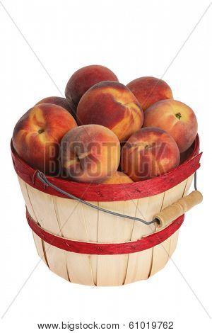 Bushel of peaches on white background