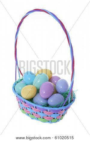Easter basket with solid colored eggs on white background