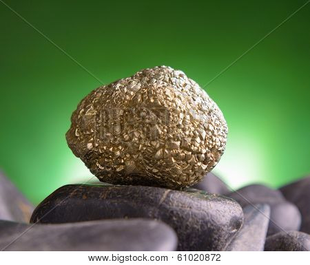 Iron pyrite also known as a fool's gold natural crystal on amethyst rock
