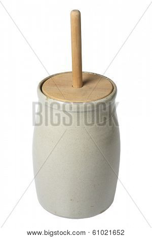 antique butter churner on white