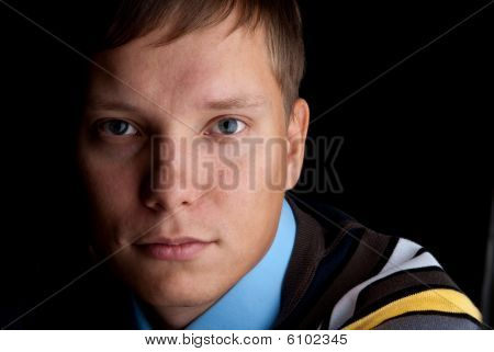 Shadowy Dark Close-up Portrait Of Young Man
