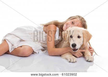 child hugging pet Labrador puppy dog