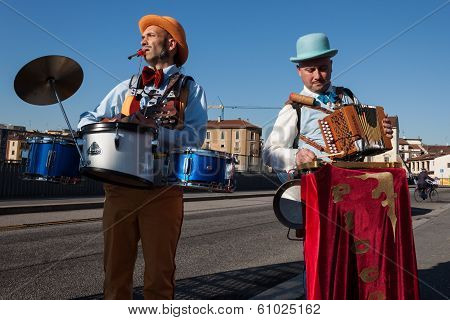 Performers Playing Music At Milan Clown Festival 2014