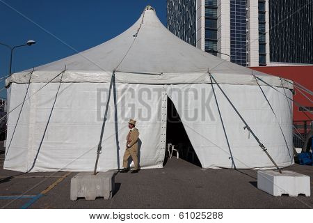 Performer Posing Outside The Big Top At Milan Clown Festival 2014