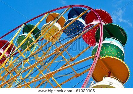 cutout of a retro Ferris wheel over the sky