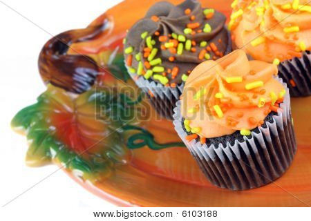 Autumn Cupcakes On Pumpkin Plate.