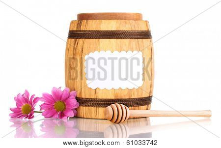 Sweet honey in barrel with drizzler isolated on white