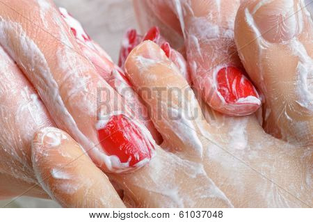 pedicure. feet massage with moisturizing or peeling cream.