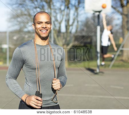 Portrait of a healthy male holding a skipping rope