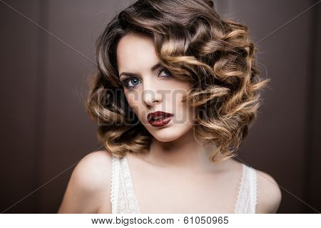 Beauty styled closeup portrait of a young woman