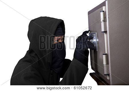 Thief Trying To Open A Safe